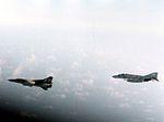 F-4J of VF-74 with Libyan MiG-23 over Gulf of Sidra 1981.jpg