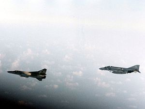 "Gulf of Sidra incident (1981) - A U.S. Navy McDonnell F-4J Phantom II of Fighter Squadron VF-74 ""Be-Devilers"" escorting a Libyan Mikoyan-Gurevich MiG-23 over Gulf of Sidra in August 1981."