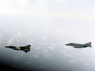 Libyan Air Force - A U.S. Navy McDonnell F-4J Phantom II of Fighter Squadron VF-74 Be-Devilers escorting a Libyan Mikoyan-Gurevich MiG-23 over Gulf of Sidra in August 1981.