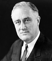 Franklin D. Roosevelt, as President of the United States initiates major economic reform in the United States.