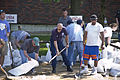 FEMA - 35617 - DHS Secretary Chertoff filling a sand bag in Waterloo, IA.jpg
