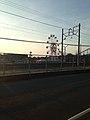 Ferris Wheel in Nishitetsu-Kashiikaen and Nishitetsu Kaizuka Line near Kashii-Kaenmae Station.jpg
