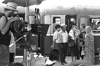 Alex Holeh Ahavah - director Boaz Davidson looks through a camera at the old railway station in Jerusalem during a scene from the film