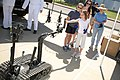 Flickr - Official U.S. Navy Imagery - An ordnance disposal robot hands a young patron a sticker during Navy Day..jpg