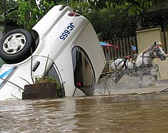 A Jakarta taxi submerged by flooded water.