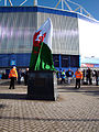 Fred Keenor Statue Covered by the Welsh Flag (8172595739).jpg