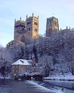 A Winter View Showing Durham Cathedral With Three Large Towers Looming High On Craggy Cliff