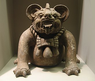 "Zapotec civilization - A funerary urn in the shape of a ""bat god"" or a jaguar, from Oaxaca, dated to AD 300–650. Height: 9.5 in (23 cm)."
