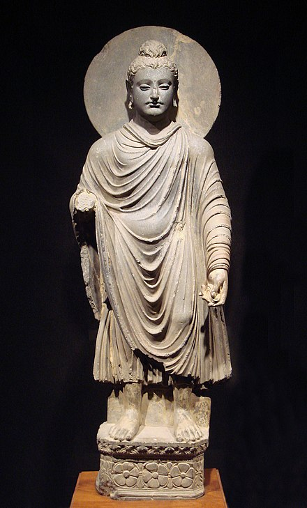 One of the first representations of the Buddha, 1st-2nd century AD, Gandhara, Pakistan: Standing Buddha (Tokyo National Museum).