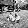 "General Montgomery with his puppies ""Hitler"" and ""Rommel"" at his mobile headquarters in Normandy, 6 July 1944. Behind can be seen his cage of canaries which also travelled with him. B6542.jpg"