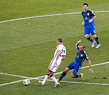 a83d5556a5c Mascherano going in for a tackle against Germany s Christoph Kramer in the  2014 FIFA World Cup Final.