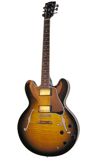 "Semi-acoustic guitar - Semi hollow-body electric guitar Gibson ES-335 has a ""solid center block"" inside a body."