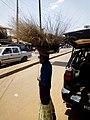 Girl hawking brooms at Oja Oba, Ilorin, Kwara State 02.jpg