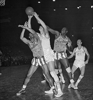 1948 Globetrotters–Lakers Game - George Mikan goes up for a shot during the 1948 Lakers-Globetrotters game