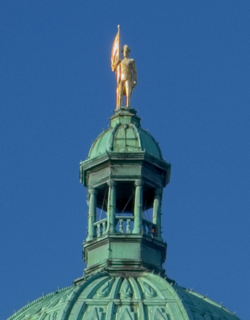 Gold covered George Vancouver statue