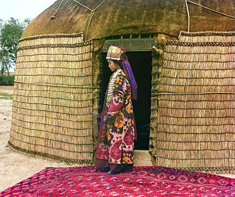 Oghuz Turks - Turkmen woman at the entrance to a yurt in Turkestan; 1911 color photograph by Prokudin-Gorskii
