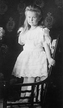 220px-Grand_Duchess_Anastasia_standing_on_chair.jpg