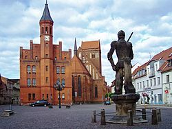 Market place of Perleberg with town hall, St James's church and Roland statue