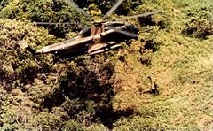 HH-53C lowers pararescueman June 1970.jpg