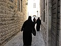 Hama, Stone alleys of the old city of Hama, Syrian women in niqab, Syria.jpg
