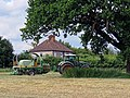 Hay baler tractor at Hatfield Broad Oak, Essex, England.jpg
