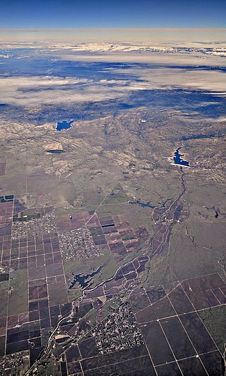 Madera County, California - Aerial view from Madera, California, toward the snow-capped Sierras.  Eastman Lake, upper left, is on the border of Madera County and Mariposa County.  Hensley Lake, uppe right, is near the center of Madera County.  Madera Lake, lower left, is on the outskirts of Madera.
