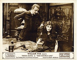 Her Double Life - Lobby card for the film featuring Holmes and Bara