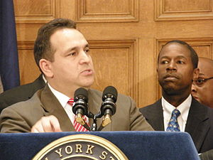 2009 New York State Senate leadership crisis - Hiram Monserrate announces he is leaving the coalition and returning to the Democrats as Malcolm Smith looks on.
