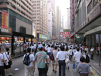 Hong Kong 1 July marches - Hong Kongers dressed in white and walked out along Paterson Street
