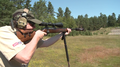 Hunter with bolt-action rifle shooting stand Sweden 01.png