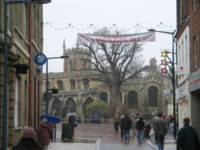 Huntingdon town centre, looking North along the High Street towards All Saints' Church.