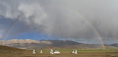 Rainbow over telescopes in Himalayas