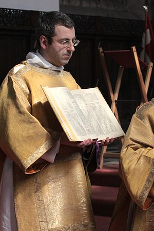 Subdeacon - Roman Catholic subdeacon holding the Gospel.