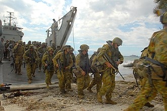 Soldiers disembarking during the Australian led INTERFET mission during the 1999 East Timorese crisis ISF troops landing on Timor beach.jpg