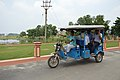 ISKCON Disciple Guiding Toto Ridden Visitors - ISKCON Campus - Mayapur - Nadia 2017-08-15 2029.JPG