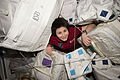 ISS-43 Samantha Cristoforetti glides through supply containers.jpg