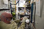 ISS-46 Scott Kelly works to clean up the WHC Liquid Carryover Issue.jpg