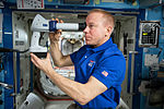 ISS-47 Tim Kopra with the Ocular Health fundoscope in the Destiny lab.jpg