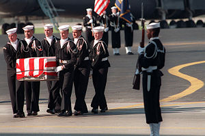 USS Iowa turret explosion - Navy pallbearers, attended by an honor guard, carry the remains of one of the victims from the turret explosion after its arrival at Dover Air Force Base on 20 April 1989.