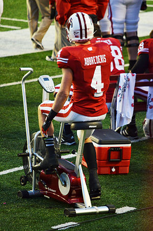 Jared Abbrederis - Abbrederis riding a stationary bike on the sideline during a game against Ohio State in 2012
