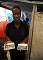 Jean Marc poses for a photo in his temporary shelter in Petionville, Haiti 100222-N-HX866-007.jpg