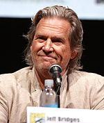 Jeff Bridges in front of a microphone during a press conference.
