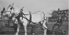 Joe A. Roseman (riding a Coldwell model mower), c. 1910.PNG