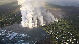 Kapoho, Hawaii - On June 4, 2018, the channel of lava from a fissure ten miles inland (from upper right) cuts through the homes of Vacationland and Kapoho Beach Lots, and begins to fill in the tide pools and Kapoho Bay.
