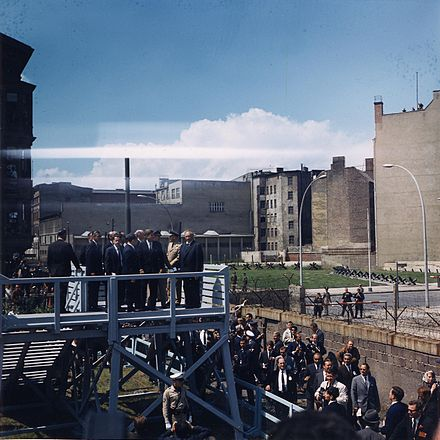 US President John F. Kennedy visiting the Berlin Wall on 26 June 1963 Kennedy in Berlin.jpg