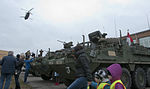 Killer Troop interacts with Polish citizens during static display 150327-A-IK997-010.jpg