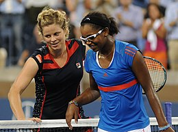 Clijsters and Duval smiling after shaking hands at the net
