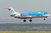 A KLM Fokker 70 landing at Bristol International Airport, England.
