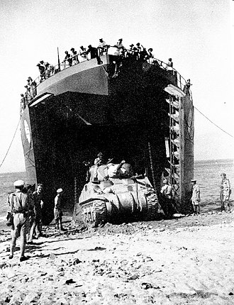 Landing Ship, Tank - A Canadian LST off-loads an M4 Sherman during the Allied invasion of Sicily in 1943