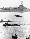 LVT-5 Amtracs pass USS Valley Forge (LPH-8) in 1968.jpg